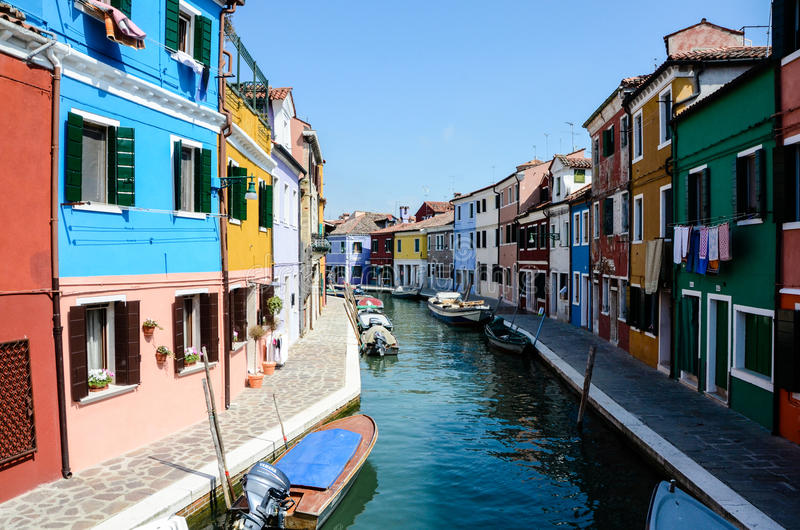 Brightly painted houses, along waterway in Burano stock image