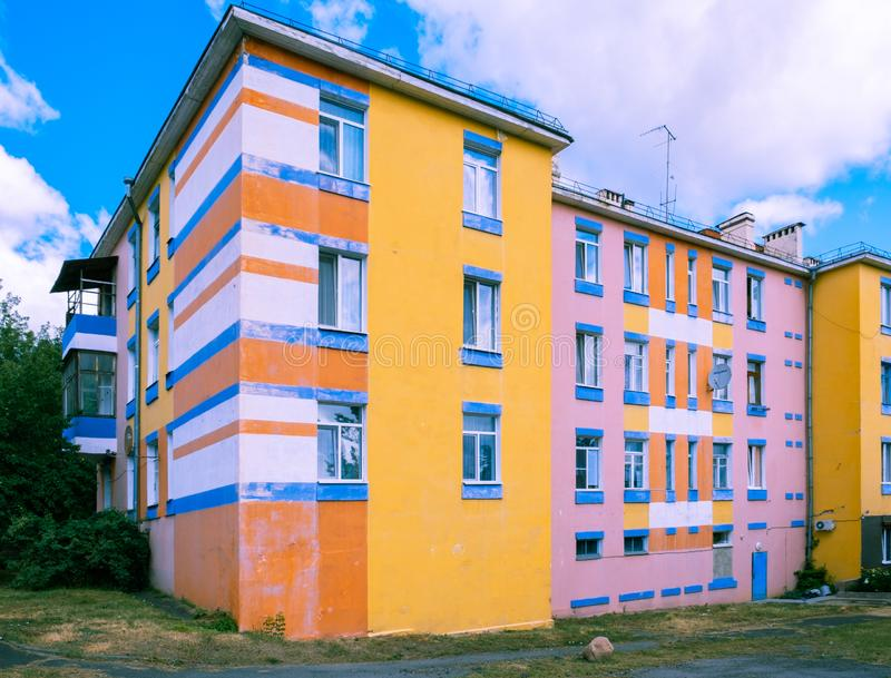 Brightly painted but old residential 4 storey building. Brightly painted but old residential 4 storey building in Mazyr, Belarus stock photos