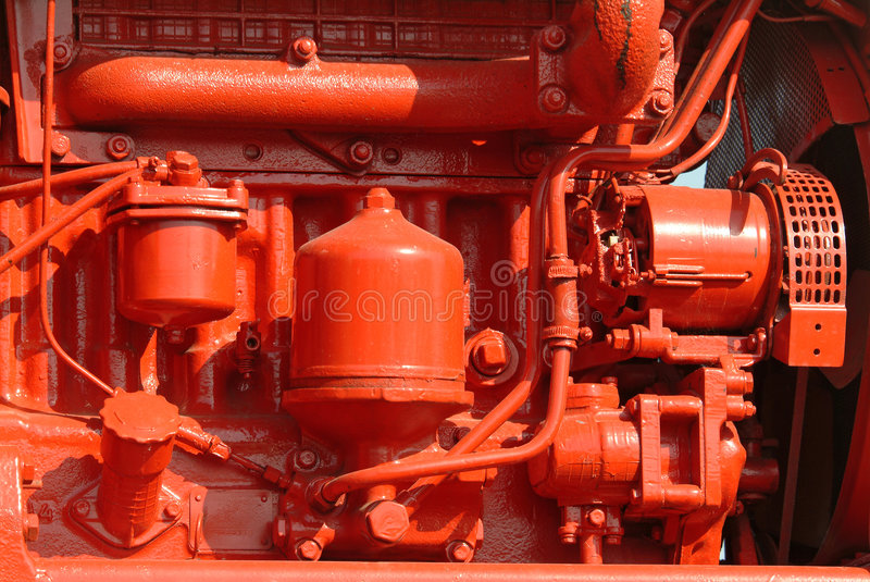Brightly painted red diesel engine stock images