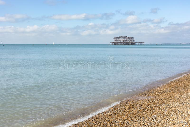 Brighton Ancient Pier. The former pier of Brighton that caught fire can still be seen from the beach stock photos