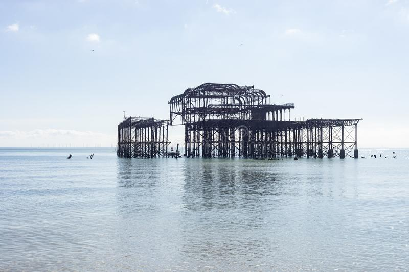 Brighton Ancient Pier. The former pier of Brighton that caught fire can still be seen from the beach royalty free stock images