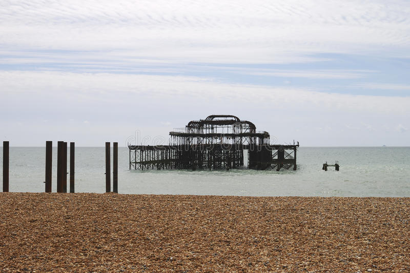 Brighton Beach and West Pier. UK. West Pier viewed from the shingle beach. Brighton. East Sussex. England royalty free stock image