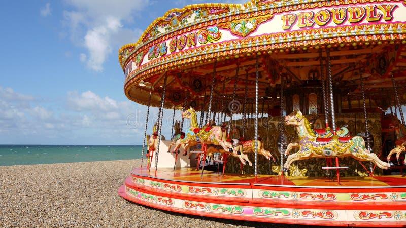 Brighton: carrusel en panorama de la playa fotografía de archivo libre de regalías