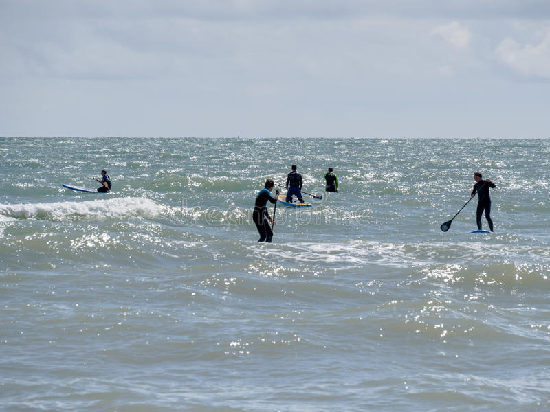 BRIGHTON, EAST SUSSEX/UK - MAY 24 : People paddle boarding at Br stock photography