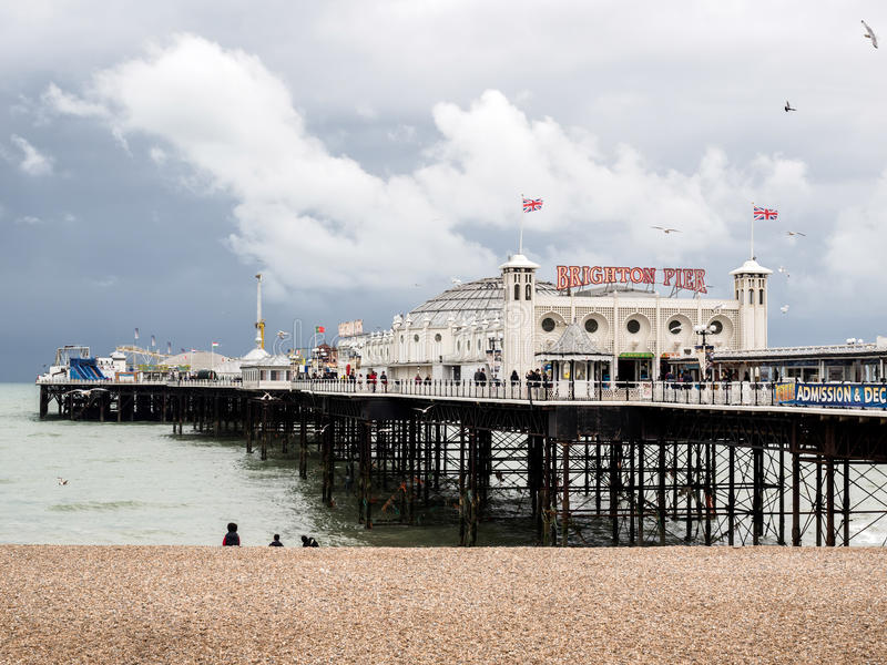 BRIGHTON, EAST SUSSEX/UK - MAY 24 : View of Brighton Pier in Brighton East Sussex on May 24, 2014. Unidentified people stock images