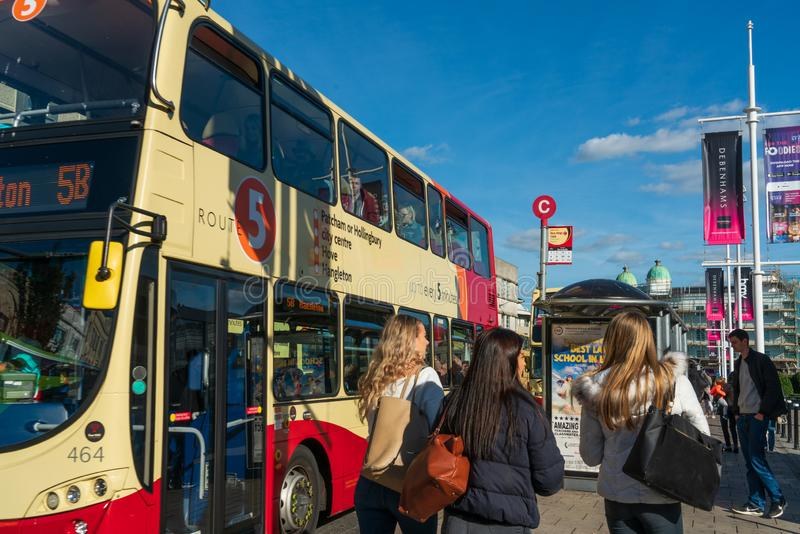 Brighton, England-1 October,2018: Bus stop with digital data board information sign for passenger with red two double decker buses. In Brighton city town with stock photos