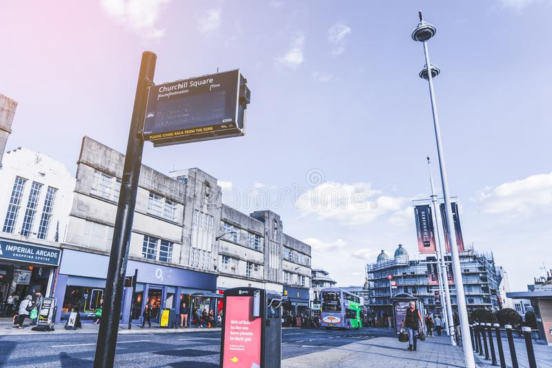 Brighton, England-1 October,2018: Bus stop with digital data board information sign for passenger with red two double Decker buses royalty free stock photos