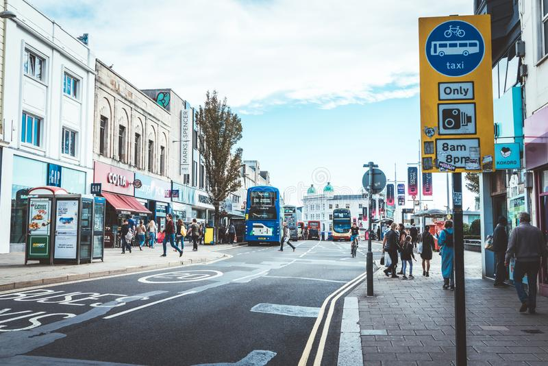 Brighton, England-1 October,2018: Bus stop with digital data board information sign for passenger with red two Double Decker buses. In Brighton city town with royalty free stock photography