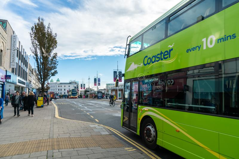 Brighton, England-1 October,2018: Bus stop with digital data board information sign for passenger with red two Double Decker buses. In Brighton city town with stock photo