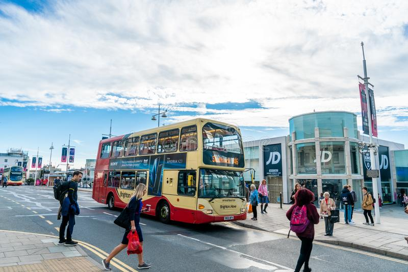 Brighton, England-1 October,2018: Bus stop with digital data board information sign for passenger with red two Double Decker buses. In Brighton city town with stock image