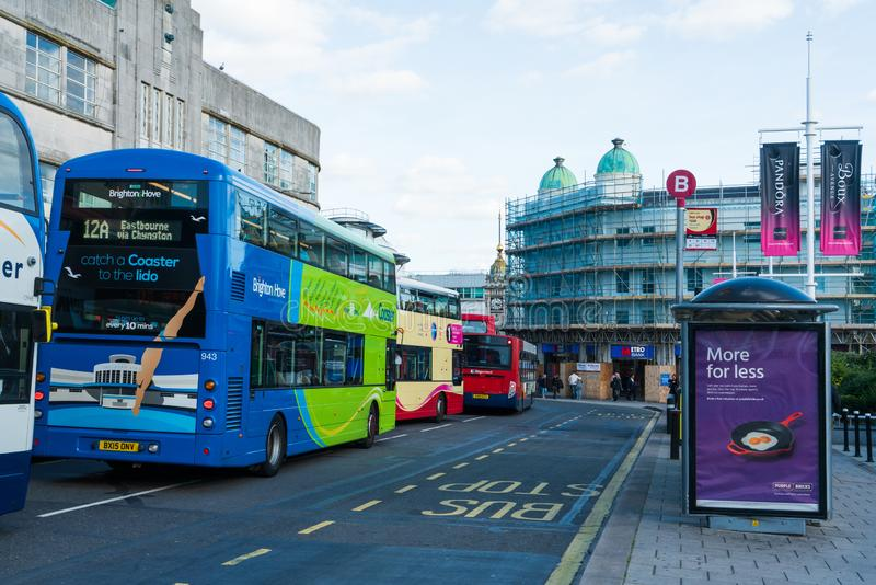 Brighton, England-1 October,2018: Bus stop with digital data board information sign for passenger with two double decker buses. In Brighton city town with royalty free stock image
