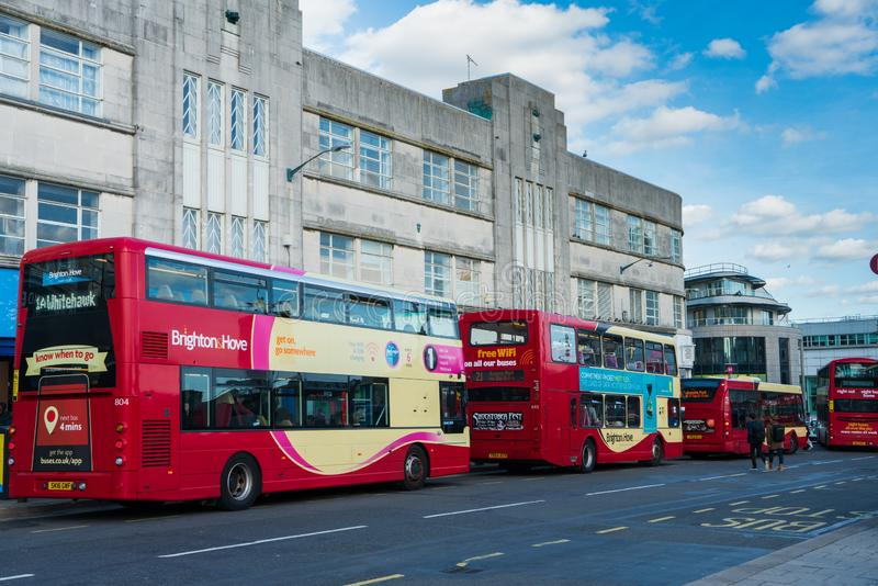 Brighton, England-1 October,2018: Bus stop with red two double decker buses in Brighton city town with traffic in the morning. Brighton, England-1 October,2018 stock photography