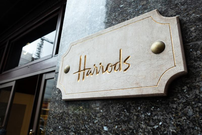 Brighton, England-18 October,2018: The famous place for shopping Harrods Department Store with the name in Golden sign on white. Marble at the entrance of the stock photography