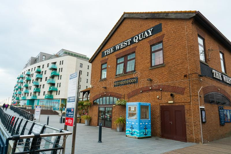 The popular place The West Quay wetherspoons pub and restaurant in Brighton Marina, Brighton, UK. Brighton, England-2 October,2018: The popular place The West royalty free stock image