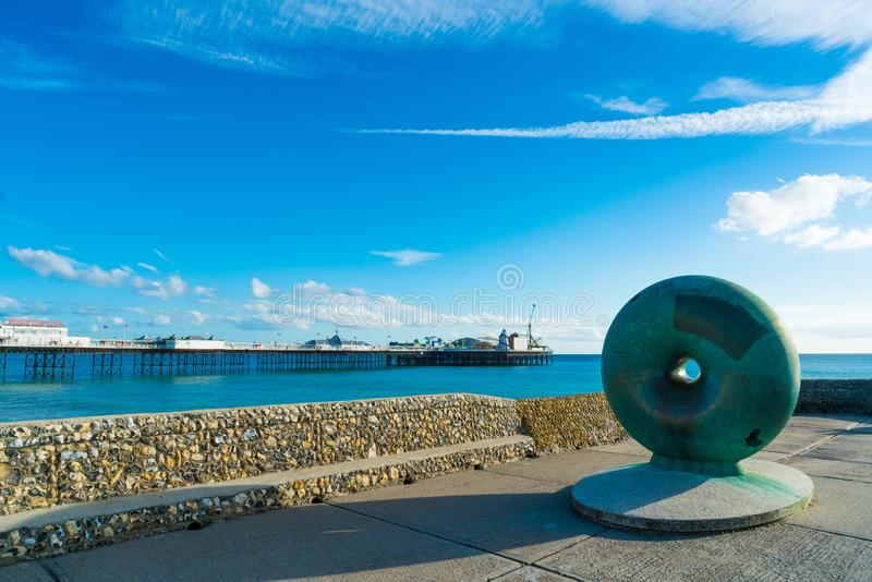 Brighton, England-19 October,2018: The sights, landmarks, monuments and statues public artwork Afloat by artist Hamish Black. A circular big green bagel stock photo