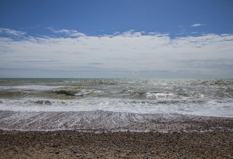Brighton, England, the UK - beach, sea and a blue sky. royalty free stock images