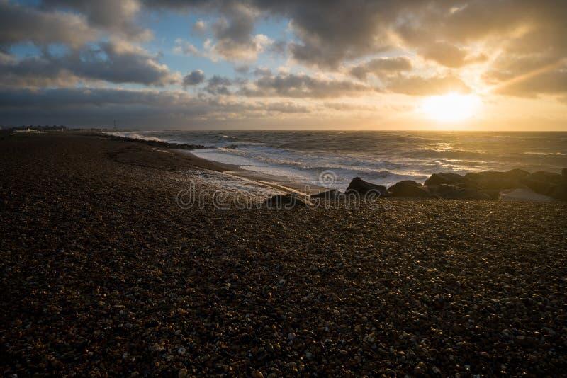 Brighton kiselstensoluppgång arkivbilder