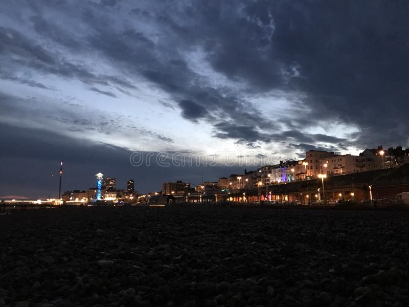 Brighton at night. Taken from the beach onlooking the Brighton night life stock images