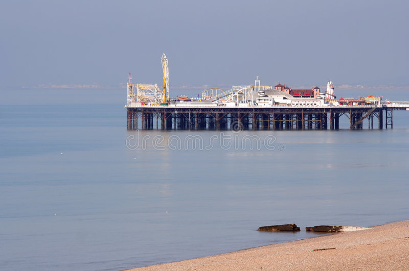 Brighton Pier. Landscape with calm sea and a bit of beach stock photography