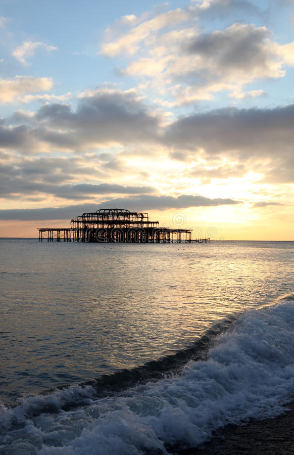 Download Brighton pier sunset waves stock image. Image of collapsed - 13443127