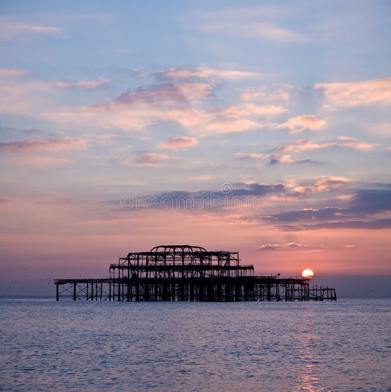 Brighton's West Pier at sunset. A moody, upbeat view sunset photo of the West Pier in Brighton, England royalty free stock image