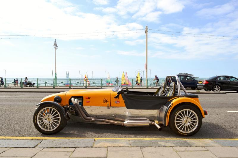 Lotus Cobra car parked in the Brighton beach avenue with old West Pier in background. stock image
