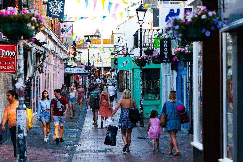 Brighton, UK - June 2018 People Walking Thru the Narrow Alley on Busy Day. Shops in The Lane in Brighton East Sussex. United Kindom. Small Local Stores and royalty free stock image