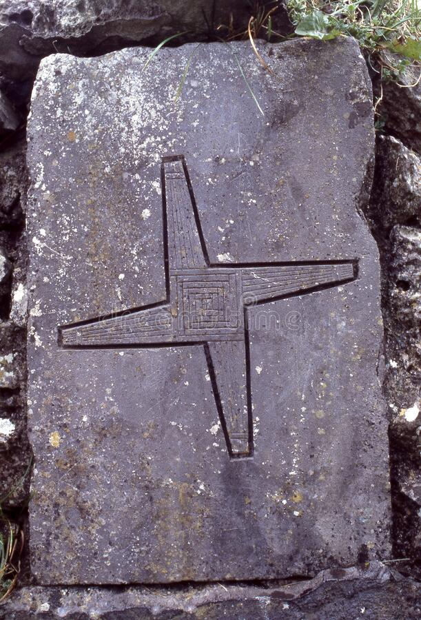 At Brigids cross carved into stone tablet St Brigids holy well  clondalkin  Dublin Ireland royalty free stock photos