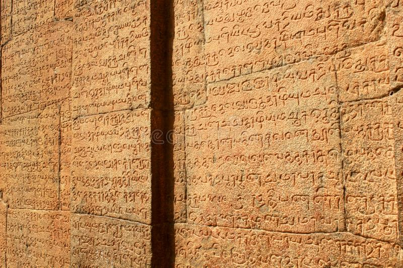 Tamil and Sanskrit inscriptions from the 11th century. The Brihadishwara temple has lot of tamil and Sanskrit inscriptions from the 11th century.Ancient temple royalty free stock images