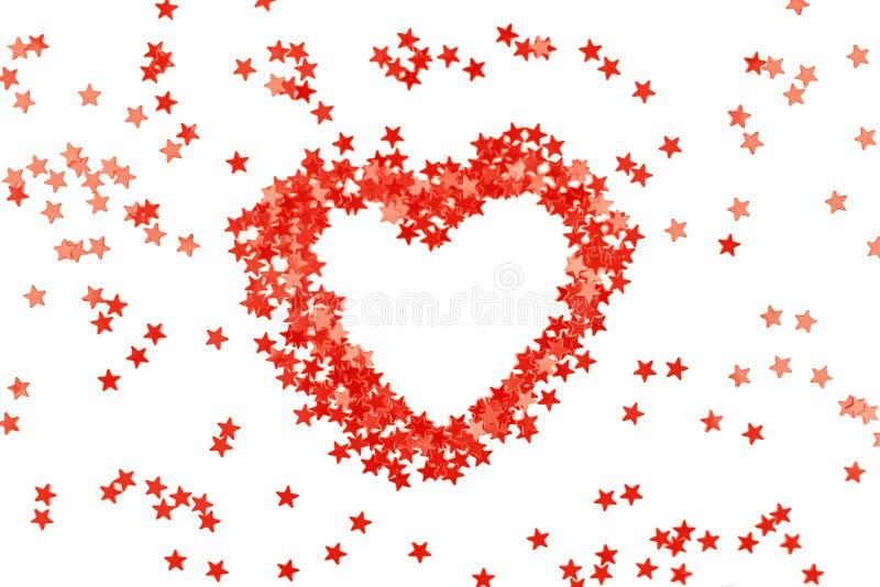 Brilla el corazón coralino de las pequeñas estrellas de la chispa imagen de archivo libre de regalías