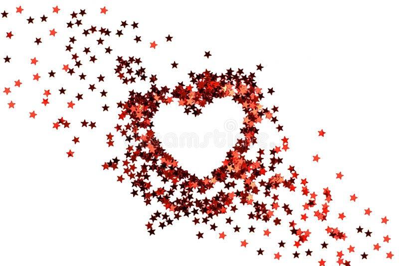 Brilla el corazón rojo de las pequeñas estrellas de la chispa fotografía de archivo
