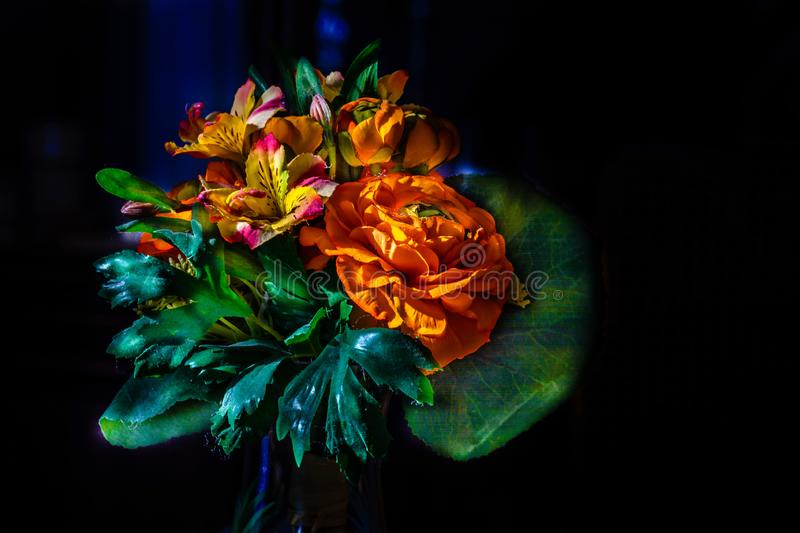Brilliant, beautiful, colorful faux fabric flower arrangement. stock images