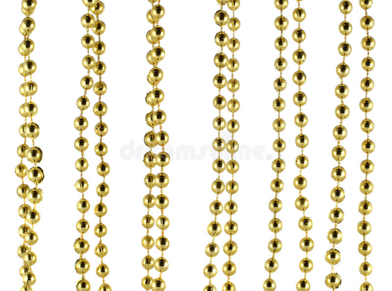 Brilliant celebratory beads of golden color. Background made of a brilliant celebratory beads of golden color royalty free stock images
