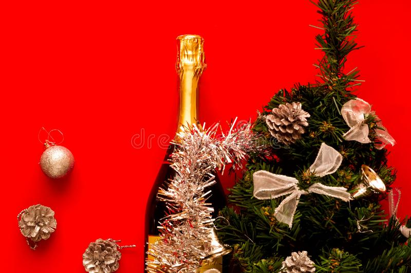 Brilliant Christmas and New Year`s decor.Decorative fir-tree with silver decoration and Bottle of champagne stock photo