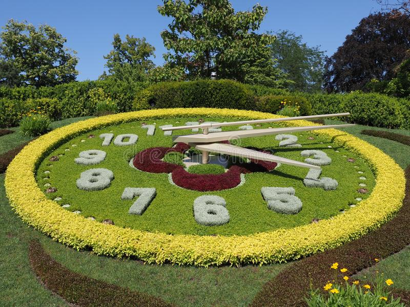 Brilliant flower clock located on western side of English garden urban public park in european Geneva city Switzerland stock images