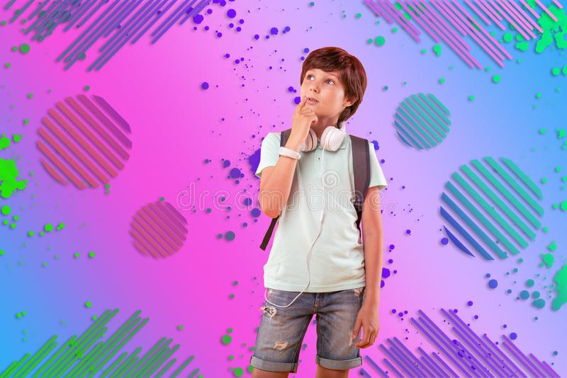 Pensive reflective boy having idea on background stock images