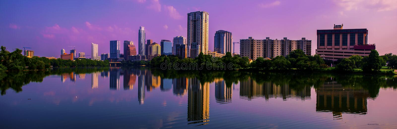 Brilliant Once in a lifetime Austin Skyline Cityscape Reflections Sunrise Pink Clouds stock photo