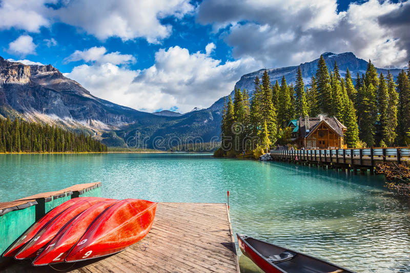 Brilliant red kayaks dry upside down royalty free stock images