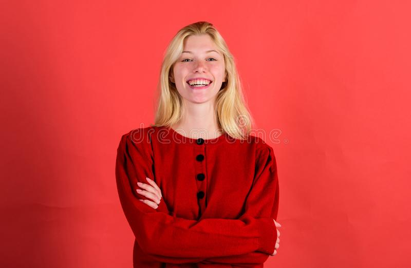 Brilliant smile concept. Girl blonde happy smiling face over red background. Emotional woman happy smiling face. Sincere stock photo