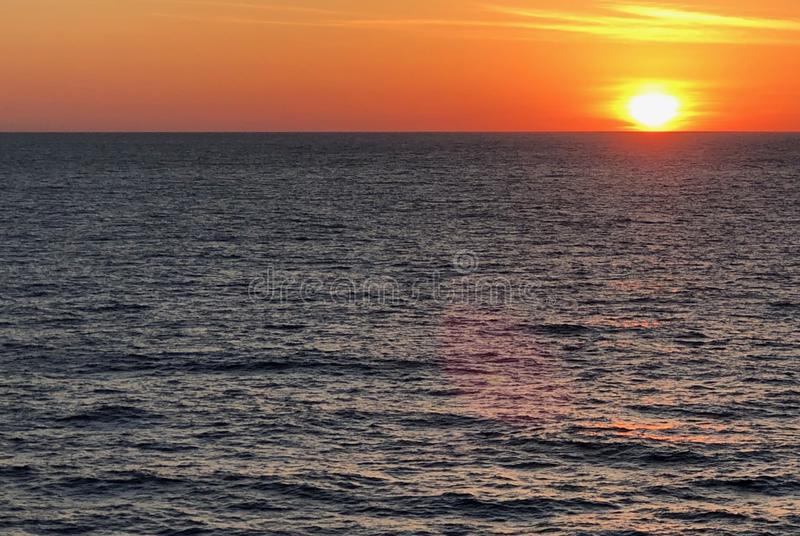 Brilliant sunset from cruise ship. royalty free stock photography