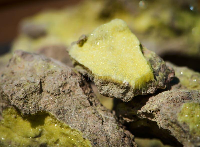 Brimstone - volcanic sulfur ore sample. On sunlight stock photo