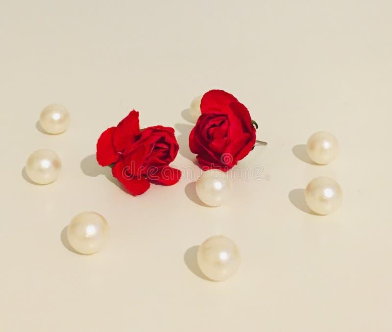 Brinco vermelho da flor imagem de stock