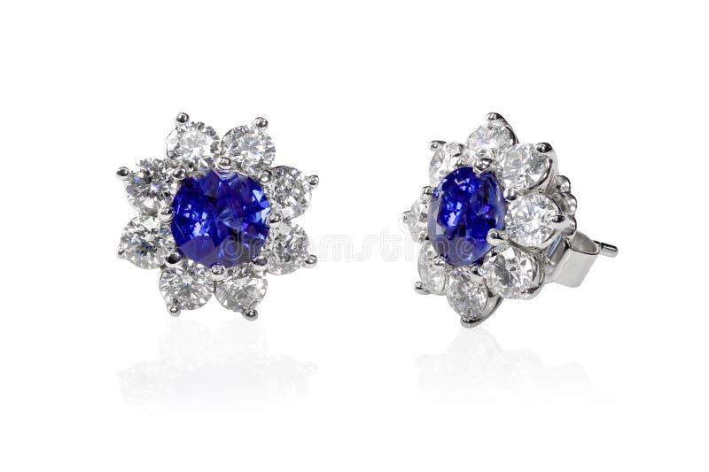 Brincos azuis de pedra preciosa e de diamante fotografia de stock