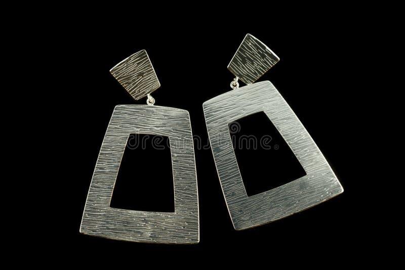 Brincos de prata com cristais fotos de stock royalty free