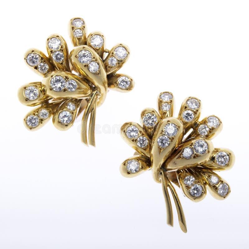 Brincos do ouro e do diamante fotos de stock