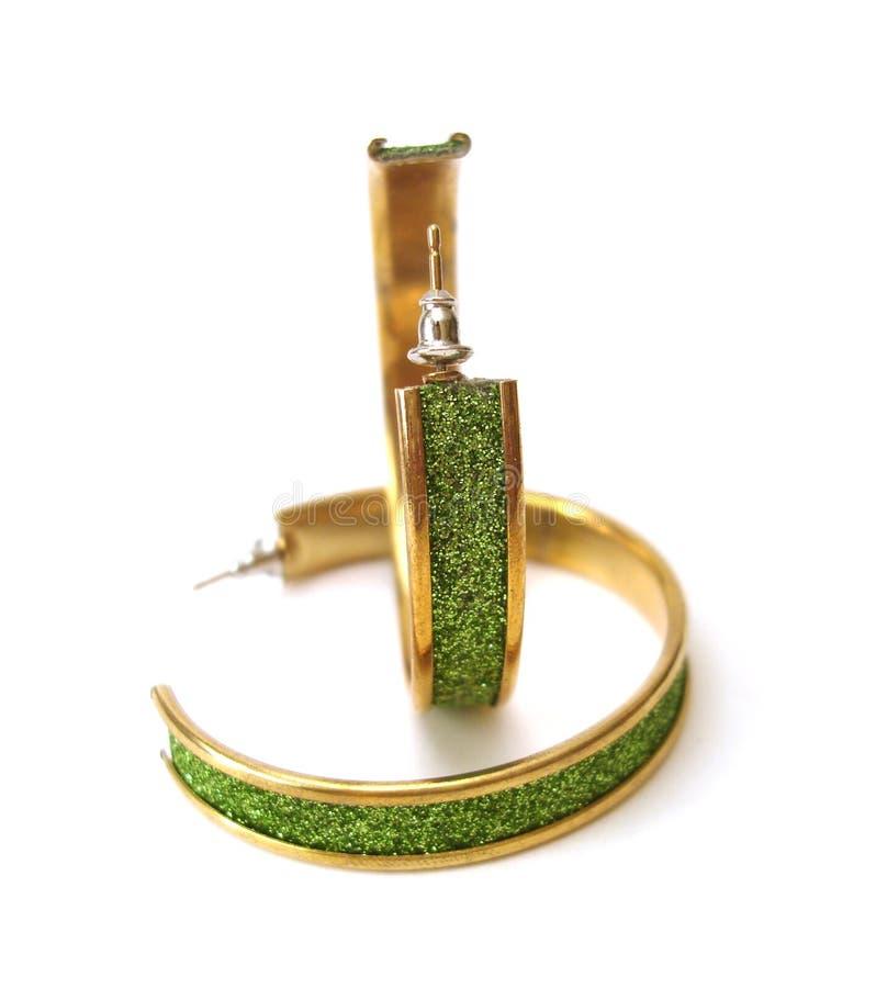 Brincos verdes isolados imagens de stock royalty free