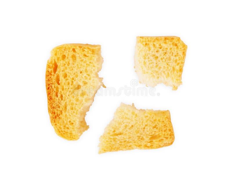 Brindes italianos brindados do bruschetta do pão isolados no fundo branco Fatias de grupo brindado do baguette fotos de stock royalty free