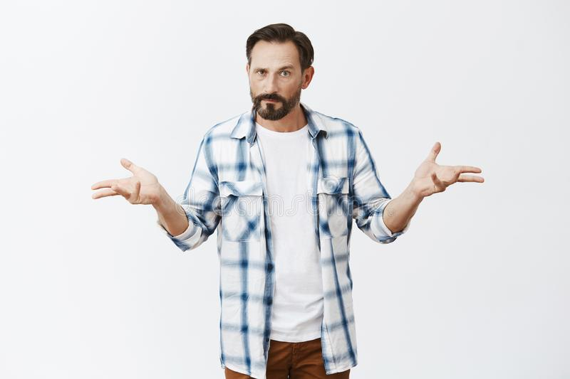So, bring it. and annoyed confident man with beard and dark short haircut, spreading palms in questioned and. Frustrated gesture, being upset, cannot understand stock photos