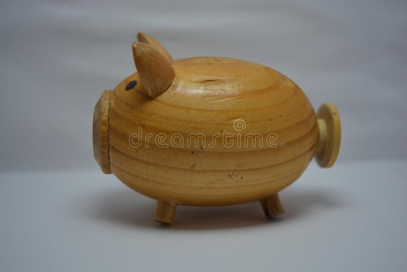 Bringen Sie Geräte, hölzernes Schwein des Durcheinanders von einem Baum für Salz unter lizenzfreie stockbilder