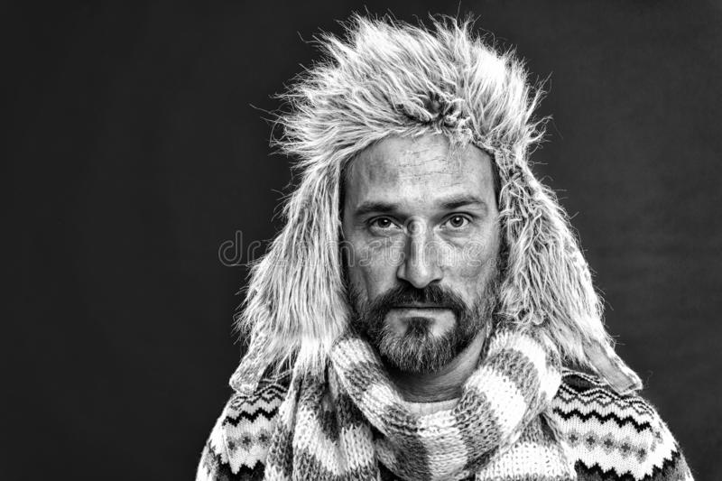 Bringing attention to his face. Fashion winter ensemble. Bearded man wearing hat with faux fur. Mature man in cold. Weather style. Fashion accessories protect royalty free stock image
